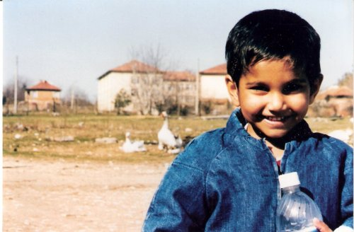 Jesse, age 4, outside his orphanage in rural Bulgaria, March 1999