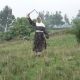Fisseha's grandmother, Tsehai, demonstrates the art of the bullwhip