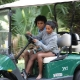 Thanksgiving 09: teaching Helen to drive golf-cart